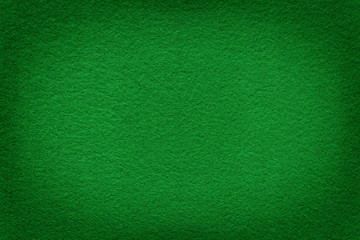 Green felt surface with light copy space in center