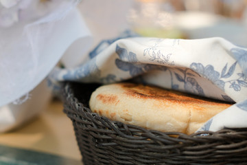 Round white home made bread in a basket