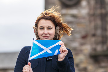 Woman with flag in Edinburgh castle in spring