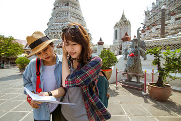 the girls searching the map at Wat po, Thailand