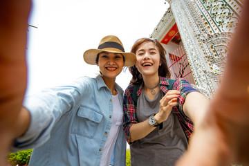 Girlfriends take a selfie at Wat pho in Thailand