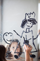 Child draws on the mirror