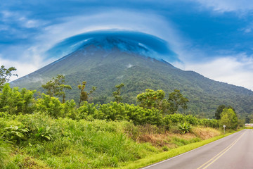 View at the volcano Arenal peak covered in clouds, Costa Rica.