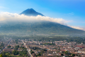 Panoramic view from Cerro de la Cruz on the city of Antigua, Guatemala and Volcano De Agua in the background.