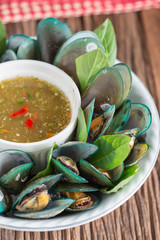 Steamed mussels with spicy sauce, Thai food. Selective focus.