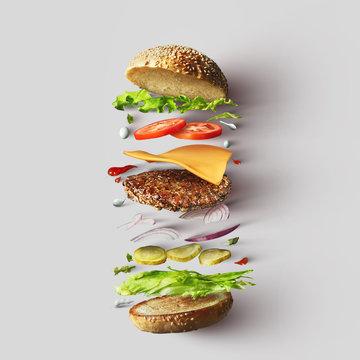 Burger ingredients against white background