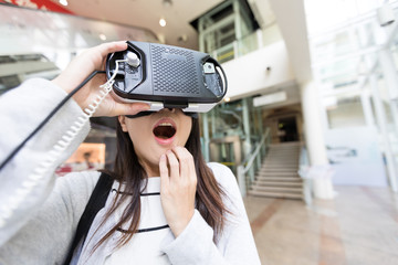 Woman watch with virtual reality and feeling surprise