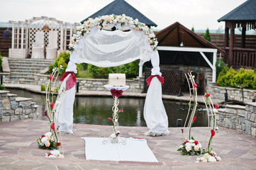 Decor wedding arch at ceremony outdoor.