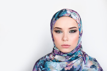 woman in colorful headscarf. colorful makeup
