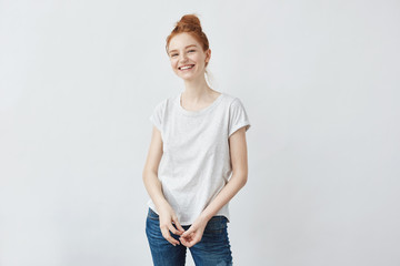 Cheerful beautiful redhead girl smiling. White background. Copy space.