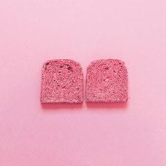 two slices of toast. all painted in pink. fashion food of breakfast.