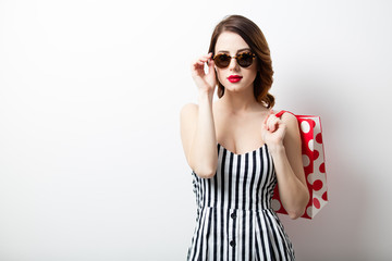 portrait of beautiful young woman with shopping bag on the wonderful white studio background