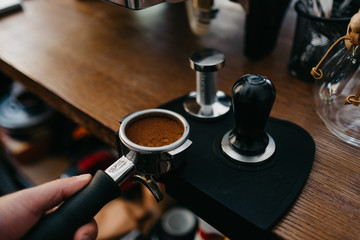 Hand of barista making coffee
