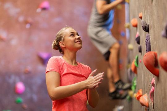 man and woman exercising at indoor climbing gym