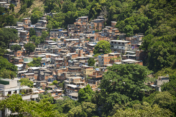 Hillside favela community growing up into the jungle on the outskirts of the city in Rio de janeiro, Brazil