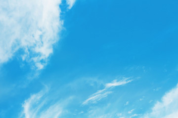 blue sky and soft white clouds