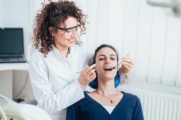 Female dentist working in her dentist office.