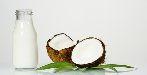 Delicious fresh nutritious coconut milkshake on the background of the white walls, the concept: useful, vitamin, bio, protein.