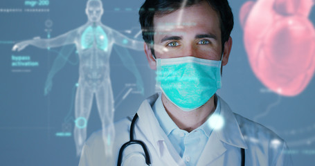 A physician, surgeon, examines a technological digital holographic plate represented the patient's body, the heart lungs, muscles, bones. Concept: Futuristic medicine, world assistance, and the futurу