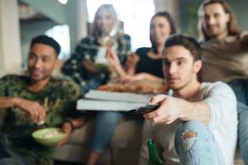 Blur image of a five friends sitting with pizza