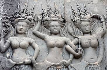 Ancient relief with Apsaras at Angkor Wat Temple, Cambodia