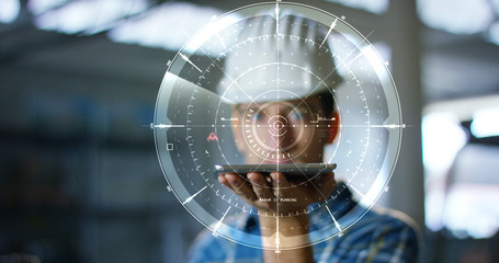 A worker uses a future technology platform to verify the design in holography and augmented virtual reality. Concept: future technology, multimedia technology, futuristic engineering.