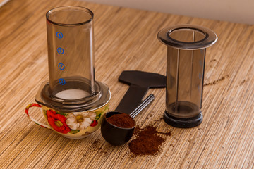 Preparation of ground coffee in aeropress - portable filter coffee maker