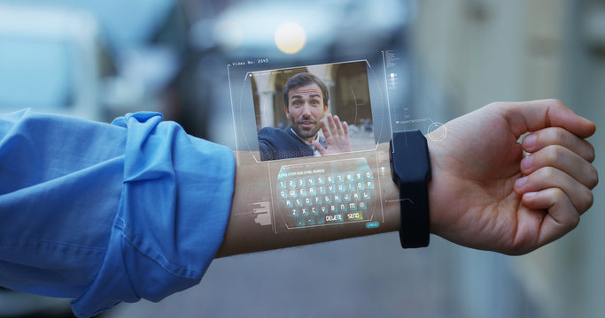 A businessman call a friend and colleague elegant dress that appears in hologram clock futuristic and technological. Concept: network, conference, technology, augmented reality and future, friendship