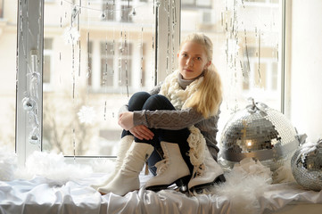 Winter photo of the girl with ice skates.