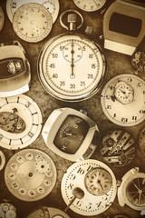 Sepia toned image vintage rusty watches and parts