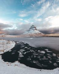 Mountain at sunrise in winter landscape