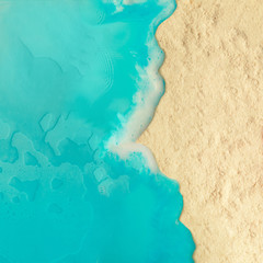 Creative minimal beach concept. Summer vacation layout with blue water and sand on bright...