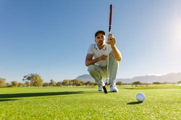 Golfer study the green before putting shot
