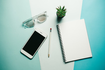 Creative flat lay photo of workspace desk with smartphone ,  minimal style