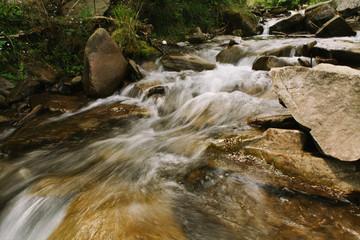 Beautiful landscape. The mountain river. Stones in a mountain river. Mountains of the Carpathians