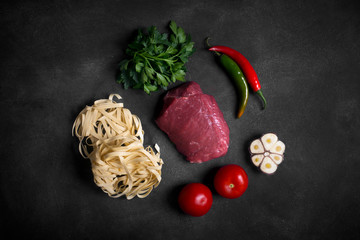 Traditional asian ingredients of lagman - noodle with vegetables and meat