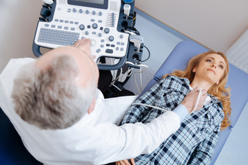 Involved patient having neck vessels ultrasound checkup in the clinic