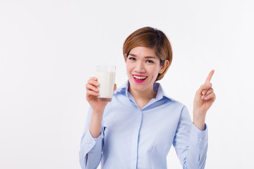 healthy asian woman holding milk, pointing up