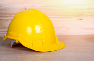 Close up safety helmet on wooden background