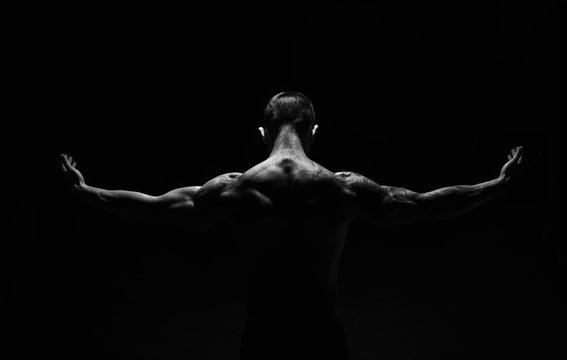 Unrecognizable man shows strong neck muscles closeup