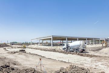 Concrete mixer passing over building site