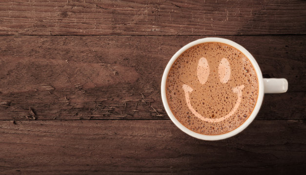 Smiley face on latte froth