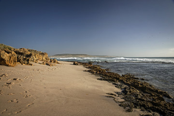 Western Australia – rough costline with blue sky