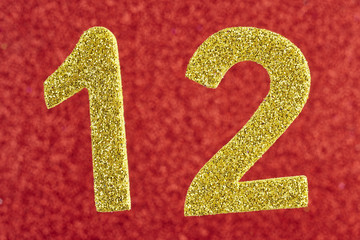 Number twelve yellow color over a red background. Anniversary.