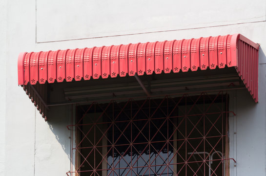 red steel awning over house window