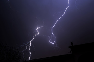Lightning Behind House Roof Top