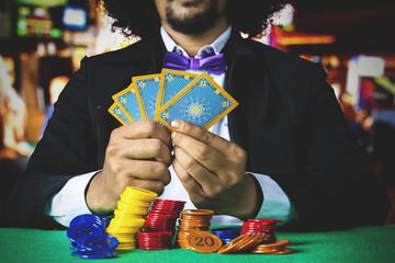 Gambler holds poker cards