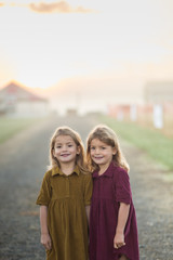Portrait of two girls smiling towards camera
