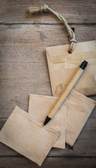 A pen and brown envelope on wooden table