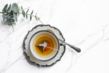 Teacup over white background, top view